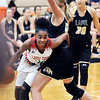John P. Cleary |  The Herald Bulletin<br /> Anderson's Tyra Ford hooks Lapels Breanna Boles around the waist as she drives the baseline.