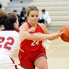 John P. Cleary |  The Herald Bulletin<br /> Frankton's Aleyah Rastetter drives the lane as Alexandria's Blaine Kelly tries to defend.