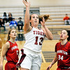 John P. Cleary |  The Herald Bulletin<br /> Alexandria's Mackenzie McCarty drives the lane for an open shot between Frankton players Sydney Tucker and Destyne Knight.