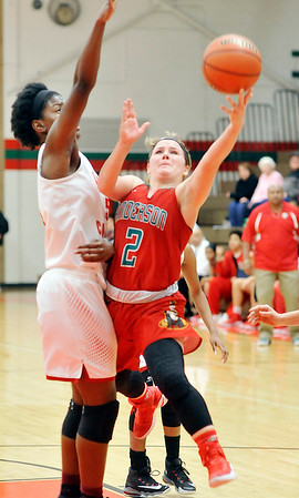 John P. Cleary |  The Herald Bulletin<br /> Anderson's Kaite Martin puts up a shot as she drives the lane against Liberty Christian's Melody Davison.