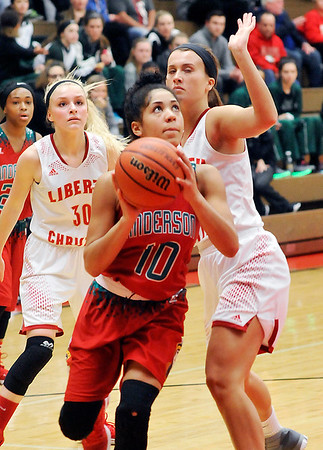 John P. Cleary |  The Herald Bulletin<br /> Anderson's Erin Martin splits Liberty Christian's defenders as she drives to the basket.