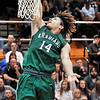 John P. Cleary |  The Herald Bulletin<br /> Pendleton Heights Eli Pancol goes up for one of his rim-rattling dunks.