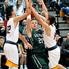 John P. Cleary |  The Herald Bulletin<br /> Pendleton Heights Trent Miller splits Alenandria defenders Avery Paddock and Sam Hensley to get a shot off.