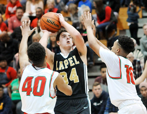John P. Cleary    The Herald Bulletin<br /> Anderson's Brandon Haralson and Joseph Jones puts on the defensive pressure on Lapel's Cole Alexander as he drives for a shot.