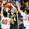 John P. Cleary |  The Herald Bulletin<br /> Anderson's Brandon Haralson and Joseph Jones puts on the defensive pressure on Lapel's Cole Alexander as he drives for a shot.