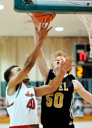 John P. Cleary |  The Herald Bulletin<br /> Lapel's Bryce Carpenter gets a hand on the ball for a block as Anderson's Brandon Haralson tries to lay the ball off the glass  during a fast break.