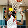 John P. Cleary |  The Herald Bulletin<br /> Anderson's JoMel Boyd throws down a dunk off a break away.