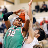 John P. Cleary |  The Herald Bulletin<br /> Anderson's Marquavius Beverly gets the ball blocked by Liberty Christian's Joshua Tufts as Beverly was driving the lane.
