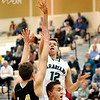 John P. Cleary |  The Herald Bulletin<br /> Pendleton Heights Mark Albers pulls up for a shot against Lapel's Jon Ross Richardson.