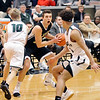 John P. Cleary |  The Herald Bulletin<br /> Lapel's Jon Ross Richardson looks for a player to pass as Pendleton's Karsten Windlan and Eli Pancol put pressure on him.