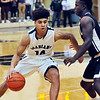 John P. Cleary |  The Herald Bulletin<br />  Pendleton Heights Eli Pancol drives into the lane as lapel's Preston Scott defends.