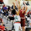 Don Knight |  The Herald Bulletin<br /> Alexandria's Mackenzie McCarty draws a foul from Anderson's Alandis Hill as she shoots in the lane during the Girls Madison County Basketball Tournament championship at Lapel on Friday.