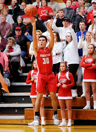 Don Knight   The Herald Bulletin<br /> Frankton's Kayden Key releases a three-point shot as the Eagles faced the Alexandria Tigers in the Madison County Championship on Saturday.
