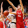 Don Knight | The Herald Bulletin<br /> Alexandria's Sam Hensley draws a foul from Frankton's Will Whatley on a drive to the basket during the Madison County Championship on Saturday.