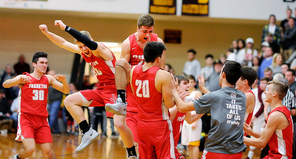 Don Knight | The Herald Bulletin<br /> Frankton celebrates the school's first Madison County Championship after beating Alexandria on Saturday.