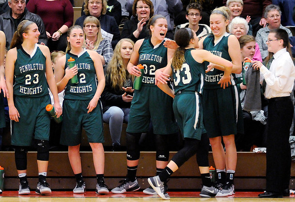 Don Knight | The Herald Bulletin<br /> Pendleton Heights starters come out of the game in the final minutes as the Arabians won the girls county basketball championship 71-50 over Anderson at the Teepee on Friday. From left are Sam Hammel, Lauren Landes, Adrienne Phillips, Kelsey Burton and Ashley King.