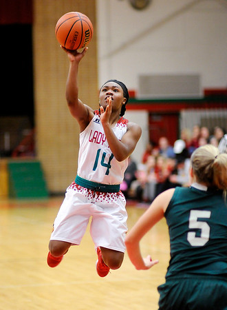 Don Knight | The Herald Bulletin<br /> Anderson's Dee Dee Sutton shoots as she soars into the lane as the Lady Tribe played Pendleton Heights in the girls county basketball championship on Friday.