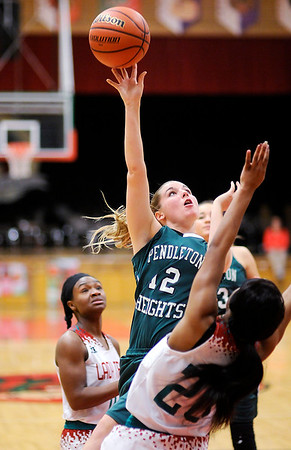 Don Knight   The Herald Bulletin<br /> Anderson played Pendleton Heights in the girls county basketball championship on Friday.
