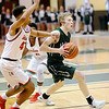 Don Knight |  The Herald Bulletin<br /> Pendleton Heights Justin Shupe drives into the lane as he is guarded by Anderson's Brandon Haralson during the Madison County Boys Basketball Tournament championship on Saturday.
