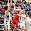 Frankton's Ethan Bates goes up to the basket as Lapel's Caden Licks tries to block his path.