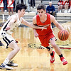 Frankton's Ethan Bates tries to get a step on Landon Bair of Lapel as he drives the ball into the front court.