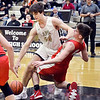 Lapel's Gage White dries to drive through Frankton's Ethan Bates in the paint and was called for a foul.