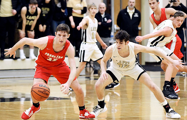 Frankton vs Lapel in boys basketball in first round of the Madison County Tourney.