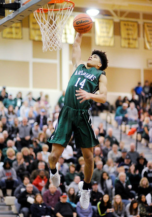Don Knight | The Herald Bulletin<br /> Pendleton Heights' Eli Pancol dunks after stealing the ball during the Boys Madison County Basketball Tournament on Saturday.