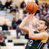 Don Knight | The Herald Bulletin<br /> Pendleton Heights' Mark Albers pulls up in the lane during the Boys Madison County Basketball Tournament on Saturday. Albers scored 24 points.