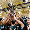 Don Knight | The Herald Bulletin<br /> The Pendleton Heights Arabians hoist the Boys Madison County Basketball Tournament trophy in the air after beating Anderson in the championship game on Saturday.