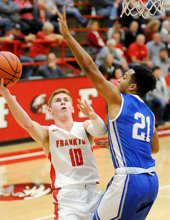 Don Knight | The Herald Bulletin<br /> Frankton's Brayton Cain draws a foul from APA's Lanson Jones on a drive to the basket as the Eagles hosted the Jets on Tuesday.