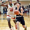 Alexandria's Jagger Orick gets a step on the Anderson's Terelle Wills as he drives the lane for a shot.