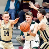 Pendleton's Triston Ross tries to pass the ball as Lapel's Noah Frazier and Gage White collapse on him.