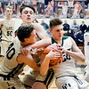 Pendleton's Triston Ross fights for the ball with Corbin Renihan and Caden Eicks of Lapel.