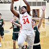 Liberty Christian's Christian Nunn goes strong to the basket for a shot.