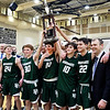 Pendleton Heights players celebrate by raising trophy for winning the Madison County Boys Basketball tournament.