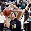 Pendleton's Aubree Dwiggins tries to block the shot of Lapel's Delany Peoples as she goes up to the basket.
