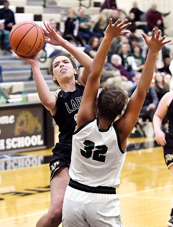 Lapel's Delany Peoples alters her shot as she go up against Kylea Lloyd of Pendleton.