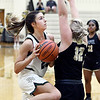 Pendleton's Kylie Davis drives to the basket as Lily Daniels of Lapel tries to block her out.