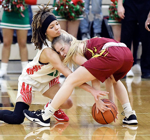 Anderson's Karlee Goodwin reaches in for the ball as Alexandria's Jada Stansberry start to loose control of her dribble.