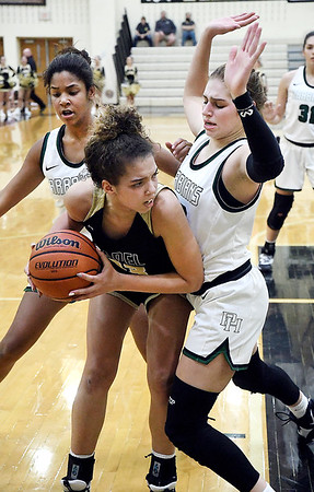 Pendleton's Kylea Lloyd and Megan Mille puts the defensive pressure on Lapel's Delany Peoples as she tries to find a teammate to pass the ball to.