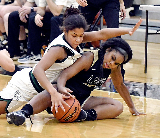 Kylea Lloyd of Pendleton and Lapel's Lacey Knepp fight for a loose ball on the floor.