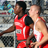 Jeffersonville sophomore sprinter Austin Hines edges ahead of Madison sprinter Wayne Sherbahn in the 100 meter dash preliminaries of the IHSAA track and field sectional. Staff photo by C.E. Branham