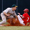 Floyd Central High School third baseman Garrett Shanks tags out Jeffersonville High School's Aaron Wenger at third base to end the fourth inning during their game at Jeffersonville on Wednesday night. Floyd Central won the game 8-5. Staff photo by Christopher Fryer