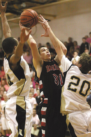 Borden junior Michael Lynch puts up a shot against Henryville Saturday night.  The host Hornets gave the Braves their first loss of the season, 89-84.  Staff photo by C.E. branham