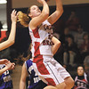 Borden senior Erin Mikel splits the Northeast Dubois defense for two of her team high 15 points in the 1A regional final Saturday.  Staff photo by C.E. Branham