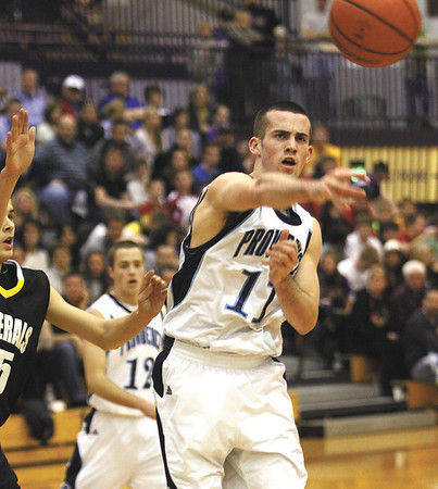 Providence guard Colin Daly passes off in the lane in a 64-52 win over Clarksville in the 2A sectional semi-final at Paoli.  Staff photo by C.E. Branham