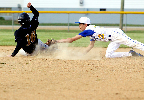 New Washington second baseman James Clemons stretches to tag out Henryville runner Joey Martin on a steal attempt. New Washington played host to the Hornets on Monday. Staff photo by C.E. Branham