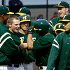 Floyd Central High School's Kyle Neafus is congratulated by his teammates after hitting a home run during the sixth inning of their home game against Providence High School on Friday night. Floyd Central won the game 9 to 3. Staff photo by Christopher Fryer