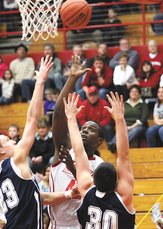 Jeff sophomore Dionte Allen scores over the Double team of Bedford North Lawrence players Cam Denney (23) and Blaine Byrer (30) Friday night.  Staff photo by C.E. Branham